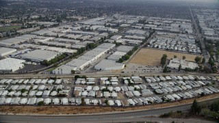 AX0157_056 - 8K stock footage aerial video of mobile homes and warehouse buildings in Chatsworth, California