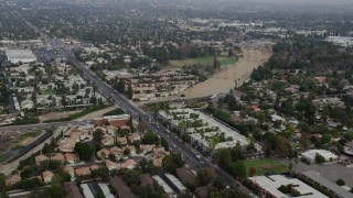 AX0157_070 - 8K stock footage aerial video flying over suburban homes and apartment buildings in Northridge, California