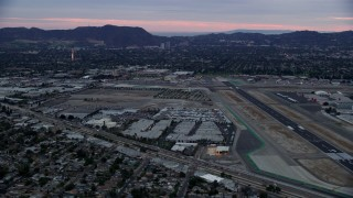 AX0158_001 - 8K stock footage aerial video dying by Burbank airport at twilight, Burbank, California