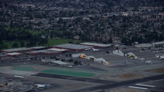 AX0158_002 - 8K stock footage aerial video of a private jet taking off from Burbank airport, twilight, Burbank, California