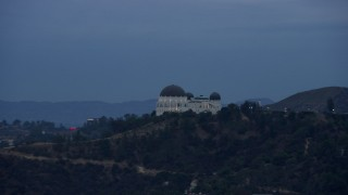 AX0158_007 - 8K stock footage aerial video tracking the Griffith Observatory, twilight, Los Angeles, California