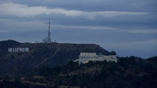 AX0158_008 - 8K stock footage aerial video tracking Griffith Observatory and reveal Hollywood Sign, twilight, Los Angeles, California