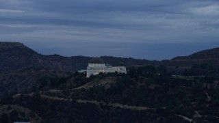AX0158_009 - 8K stock footage aerial video orbiting the front of the Griffith Observatory, twilight, Los Angeles, California