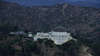 AX0158_010 - 8K stock footage aerial video of the front of Griffith Observatory at twilight, Los Angeles, California
