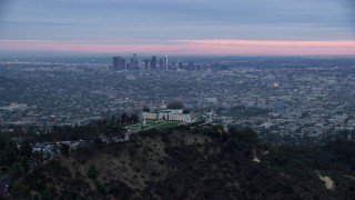 AX0158_013 - 8K stock footage aerial video of Griffith Observatory revealing downtown Los Angeles and city sprawl, twilight, California