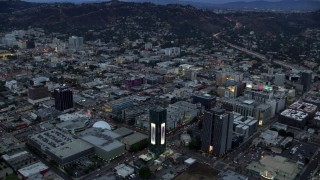 AX0158_017 - 8K stock footage aerial video of businesses and office buildings along Sunset Boulevard at twilight, Hollywood, California