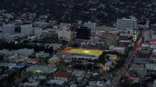 AX0158_018 - 8K stock footage aerial video of Hollywood High School football field, twilight, Hollywood, California