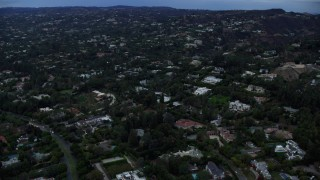 AX0158_022 - 8K stock footage aerial video of upscale homes and mansions, twilight, Beverly Hills, California