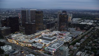 AX0158_025 - 8K stock footage aerial video passing by office buildings and shopping mall, twilight, Century City, California