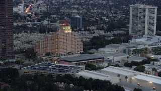 AX0158_026 - 8K stock footage aerial video orbiting the Intercontinental Hotel at twilight, Century City, California