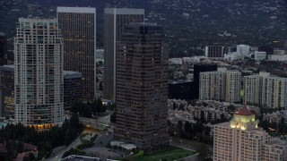 AX0158_027 - 8K stock footage aerial video orbiting Fox Tower at twilight, Century City, California