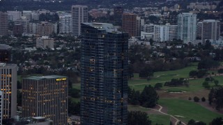 AX0158_029 - 8K stock footage aerial video orbiting new condominium, Ten Thousand, twilight, Century City, California