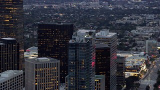 AX0158_030 - 8K stock footage aerial video orbiting the top of Ten Thousand, a luxury condominium building, Century City, California at twilight