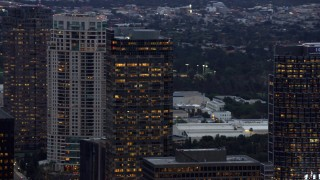 AX0158_032 - 8K stock footage aerial video orbiting office and apartment buildings, twilight, Century City, California