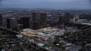 AX0158_033 - 8K stock footage aerial video orbiting Westfield shopping mall and bordering office buildings, twilight, Century City, California