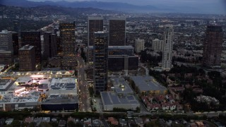 AX0158_034 - 8K stock footage aerial video of Westfield shopping mall, Constellation Place and The Century Plaza Hotel at twilight, Century City, California
