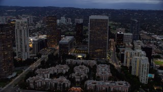 AX0158_036 - 8K stock footage aerial video orbiting away from skyscrapers and condominiums, twilight, Century City, California