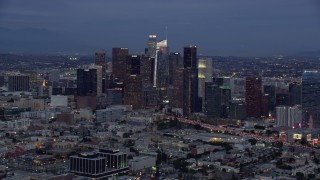 AX0158_044 - 8K stock footage aerial video of Downtown Los Angeles skyline with new skyscraper, Wilshire Grand Center, twilight, California