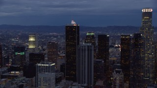 AX0158_048 - 8K stock footage aerial video circling a group of skyscrapers at twilight in Downtown Los Angeles, California