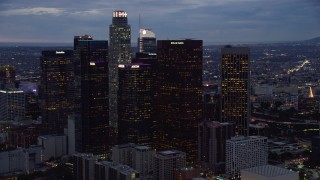 AX0158_049 - 8K stock footage aerial video of a group of skyscrapers at twilight in Downtown Los Angeles, California