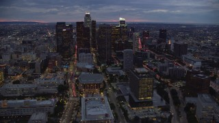 AX0158_050 - 8K stock footage aerial video of skyscrapers, Dorothy Chandler Pavilion, and 110 at twilight in Downtown Los Angeles, California