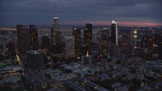 AX0158_052 - 8K stock footage aerial video passing skyscrapers at twilight in Downtown Los Angeles, California