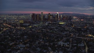 AX0158_056 - 8K stock footage aerial video approaching Downtown Los Angeles, California skyline from Echo Park Lake at twilight