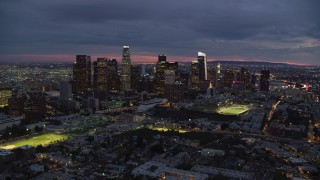 AX0158_057 - 8K stock footage aerial video flying over 101 freeway at twilight to approach Downtown Los Angeles, California