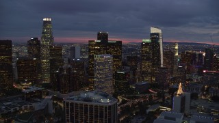 AX0158_058 - 8K stock footage aerial video approaching Downtown Los Angeles, California at twilight