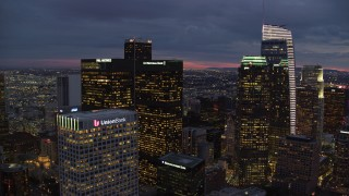 AX0158_059 - 8K stock footage aerial video flying between skyscrapers at twilight through Downtown Los Angeles, California