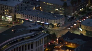 AX0158_065 - 8K stock footage aerial video tracking LAPD helicopter at twilight in Los Angeles, California