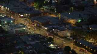 AX0158_071 - 8K stock footage aerial video tracking LAPD helicopter at twilight in Hollywood, California