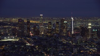 AX0158_073 - 8K stock footage aerial video approaching the Downtown Los Angeles skyline at night, California