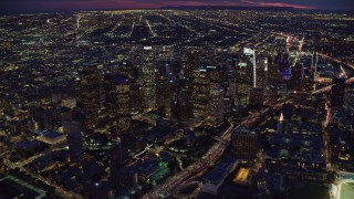AX0158_076 - 8K stock footage aerial video of Downtown Los Angeles skyscrapers at nighttime in California