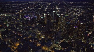 AX0158_078 - 8K stock footage aerial video of the lights and skyscrapers of Downtown Los Angeles, California at night