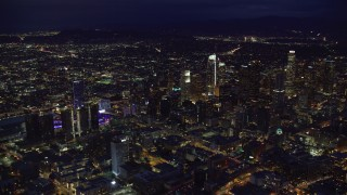 AX0158_081 - 8K stock footage aerial video flying by Downtown Los Angeles, California at nighttime
