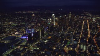 AX0158_082 - 8K stock footage aerial video of a wide view of skyscrapers at night in Downtown Los Angeles, California