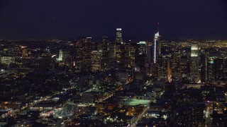 AX0158_085 - 8K stock footage aerial video passing skyscrapers at night in Downtown Los Angeles, California