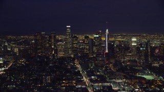 AX0158_086 - 8K stock footage aerial video of tall downtown skyscrapers at nighttime, Downtown Los Angeles, California