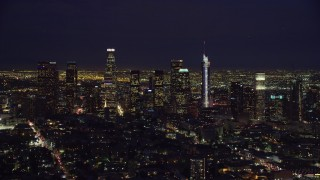 AX0158_087 - 8K stock footage aerial video of Downtown Los Angeles, California at night from north of downtown