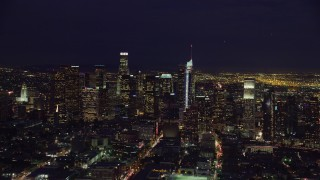 AX0158_088 - 8K stock footage aerial video flying by skyscrapers at nighttime in Downtown Los Angeles, California