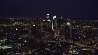 AX0158_089 - 8K stock footage aerial video of Downtown Los Angeles, California at nighttime