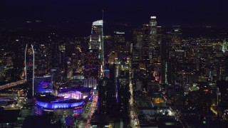 AX0158_092 - 8K stock footage aerial video of Staples Center and skyscrapers at night in Downtown Los Angeles, California