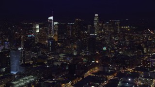 AX0158_093 - 8K stock footage aerial video of skyscrapers at night in Downtown Los Angeles, California