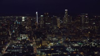 AX0158_094 - 8K stock footage aerial video of skyscrapers at night in Downtown Los Angeles, California, seen from south of downtown