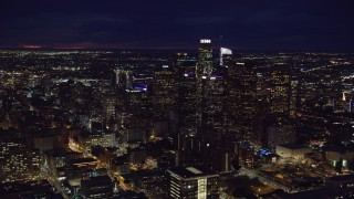 AX0158_097 - 8K stock footage aerial video of group of skyscrapers at night in Downtown Los Angeles, California