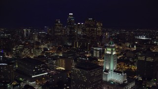 AX0158_109 - 8K stock footage aerial video of Downtown skyscrapers seen while flying by City Hall at night in Downtown Los Angeles, California