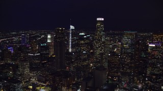 AX0158_110 - 8K stock footage aerial video approaching skyscrapers at night in Downtown Los Angeles, California