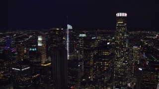 AX0158_111 - 8K stock footage aerial video of Aon Center to reveal Wilshire Grand Center at night, Downtown Los Angeles, California