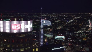 AX0158_116 - 8K stock footage aerial video orbiting the top of Wilshire Grand Center and reveal US Bank Tower at night, Downtown Los Angeles, California
